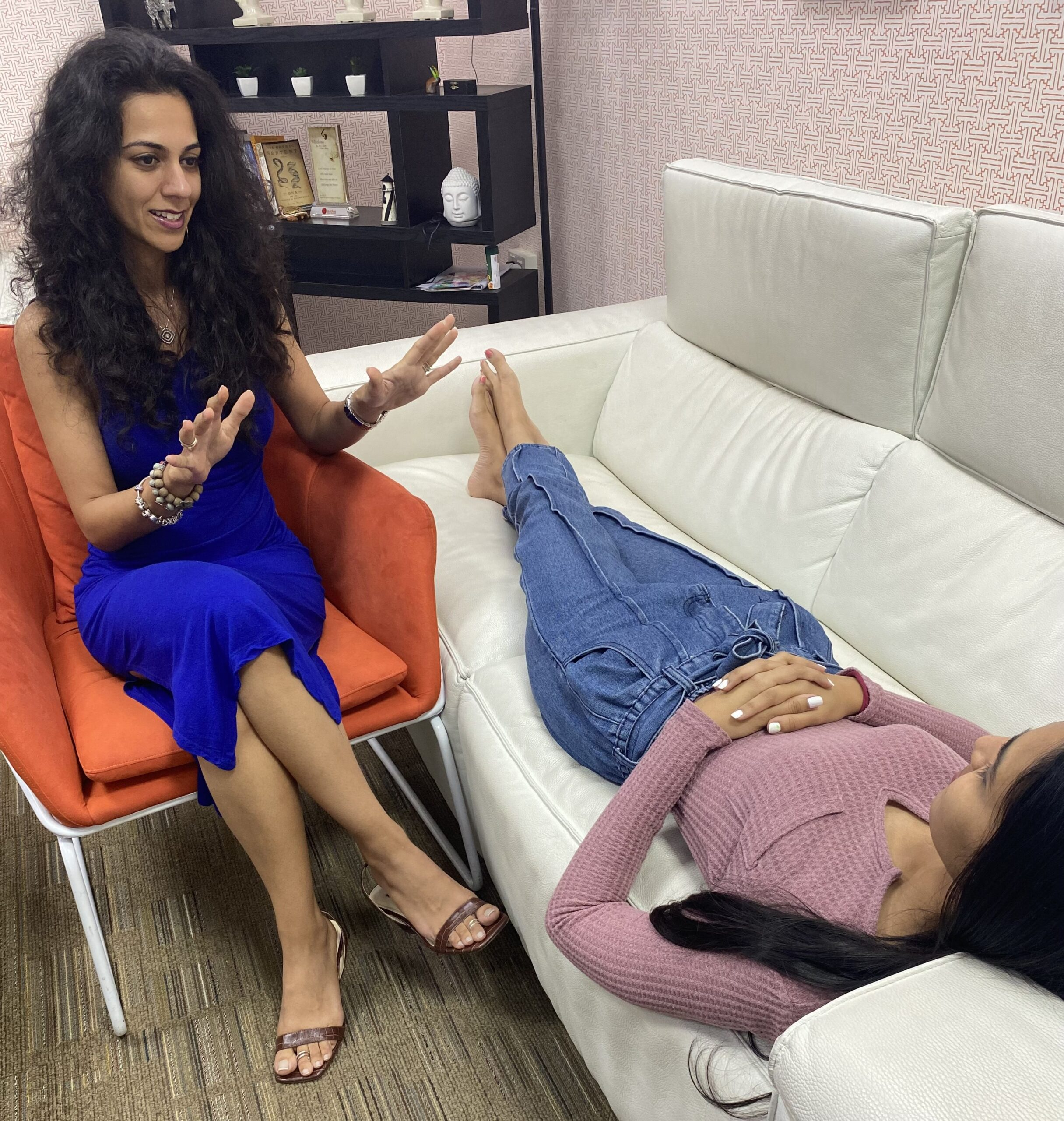 Psychologist Ankita Magdani during hypnotherapy session with client lying on couch